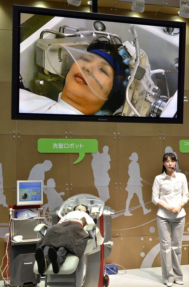 Japan's electronics manufacturer Panasonic offers a hair-washing robot with 24 fingers to massage the user's scalp and washing arms to spray water and shampoo