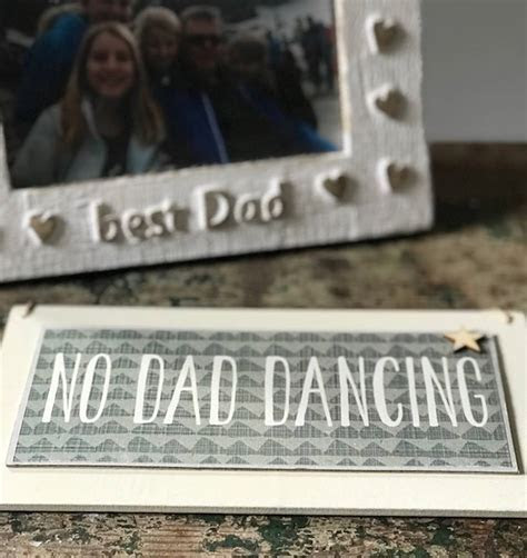 'no dad dancing' sign by the original home store   the