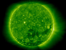 A coronal hole, the dark spot beginning just below the sun's center and extending to the right, is shown opening up in this image by NASA satellite STEREO.