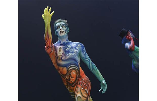 Participants gesture with their body paintings during the 15th World Bodypainting Festival in Poertschach on July 7, 2012. Some 30,000 visitors are expected at the three-day event, with over 200 artists from 44 countries showing off their creations in the hope of taking home a prestigious World Award, the equivalent of a world championship title.