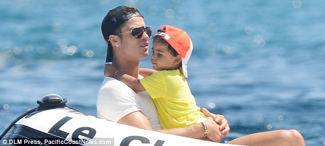 Doting daddy: Cristiano Ronaldo was spotted showering his son with affection in St. Tropez