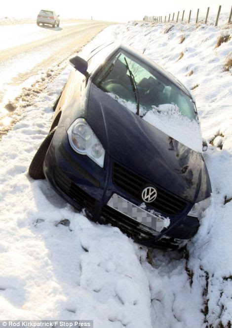 Treacherous: Driving conditions became difficult as sleet and rain froze on roads