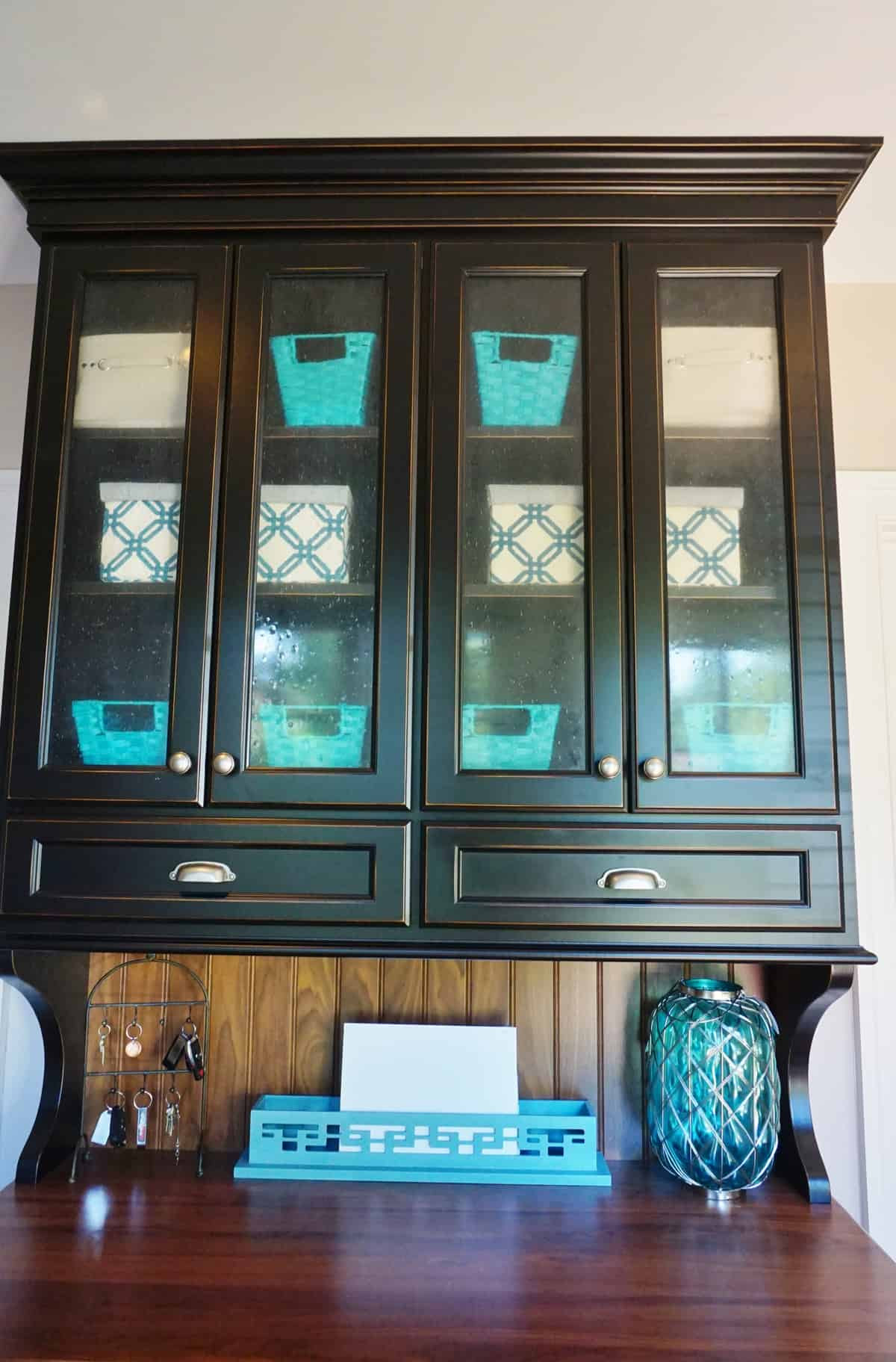 Glass Front Cabinet- Organizing Before and After ...