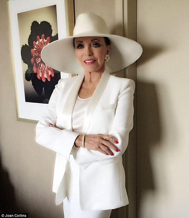 Wearing a sleek silk jacket (£450) by Australian designer Carla Zampatti in Sydney for a magazine shoot. The chic all-cream outfit - complete with a Dynasty-esque hat from the stylist - would make Alexis Carrington proud