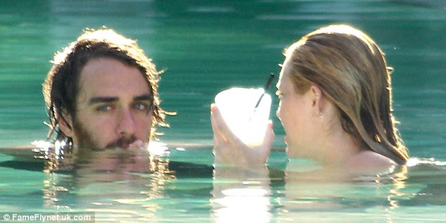 A refreshing dip: The pair were certainly enjoying the water, cooling off from the hot Miami sun