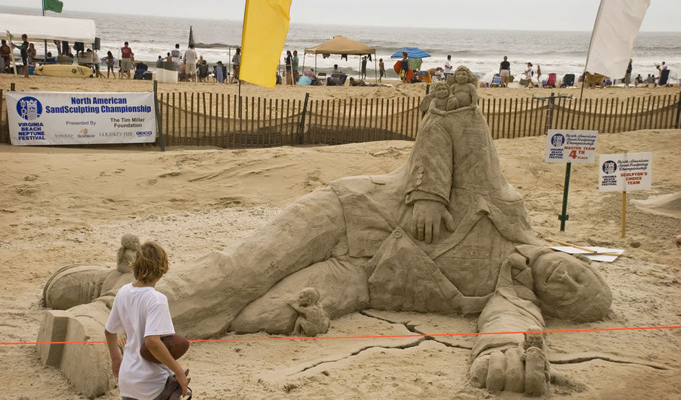 Angels and demons with a man at the Nepture Festival, Virginia Beach Sandsculpting Championship