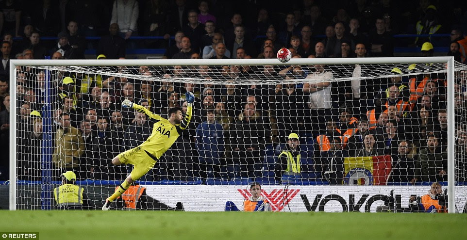 Spurs keeper Hugo Lloris can only watch on as Hazard's wondrous curling effort heads into the corner of the net to make it 2-2