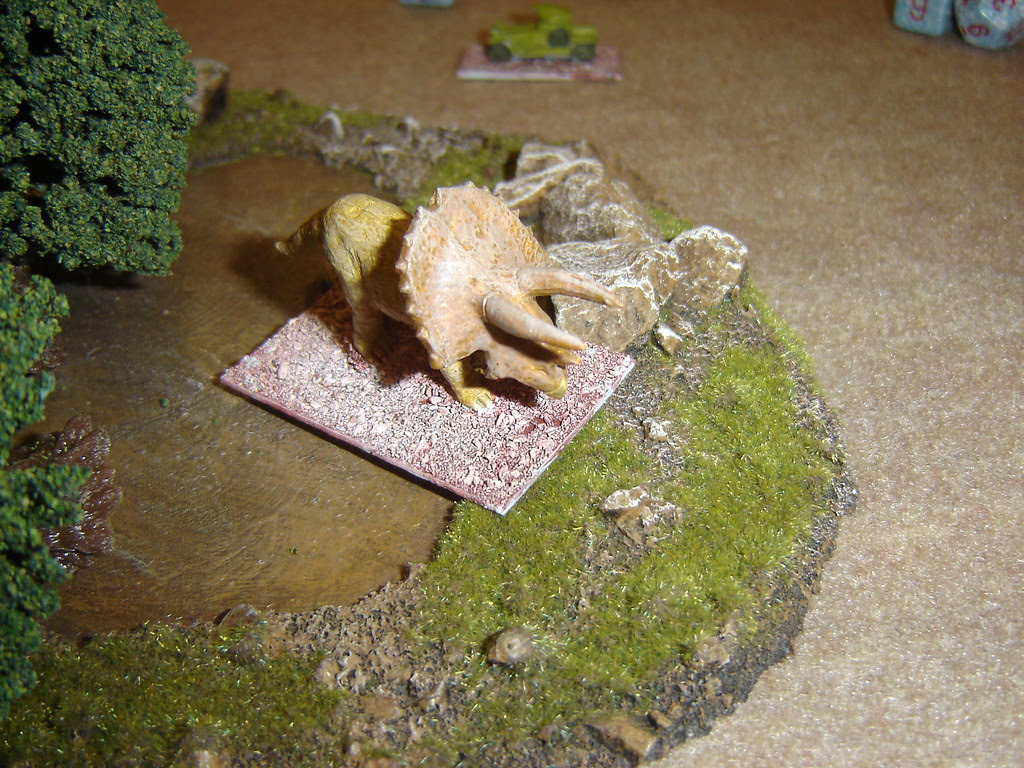 Triceratops exits forest away from armoured car
