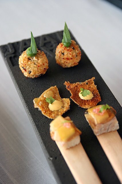 Starter bites - potato croquet, grilled chicken skin, and smoked eel with pickled apples