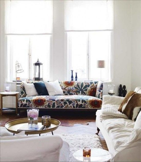 White walls and Moroccan table + great fabric on sofa