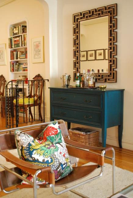 dark teal, burnished gold, caramel wasilly...and a chiang mai dragon toss pillow. eclectic, well done.