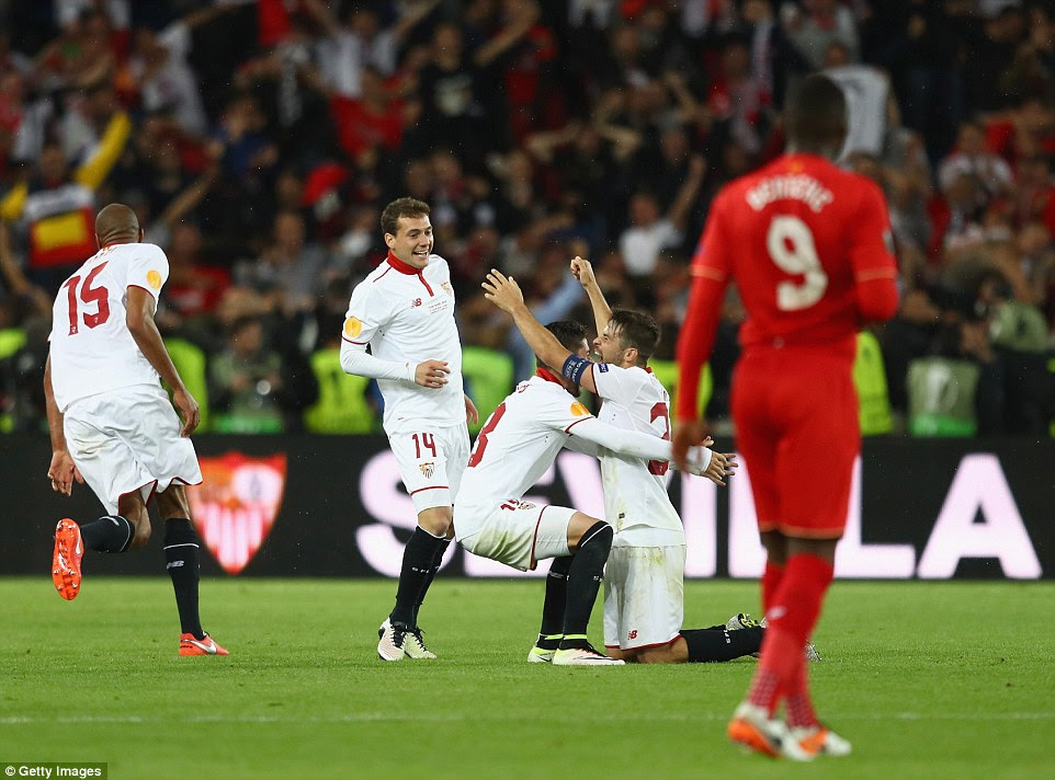 Coke drops to his knees at the final whistle as Sevilla make history with a third consecutive Europa League victory