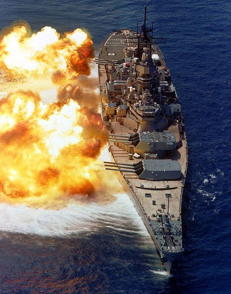 The battleship USS Iowa fires her nine 16-inch guns in a 1984 firepower demonstration.