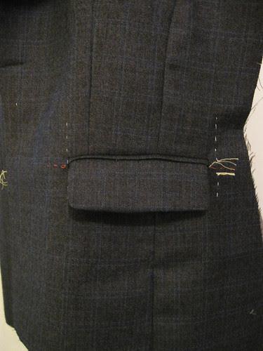 Grey jacket pocket unpressed