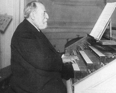 Camille Saint-Saëns at the organ