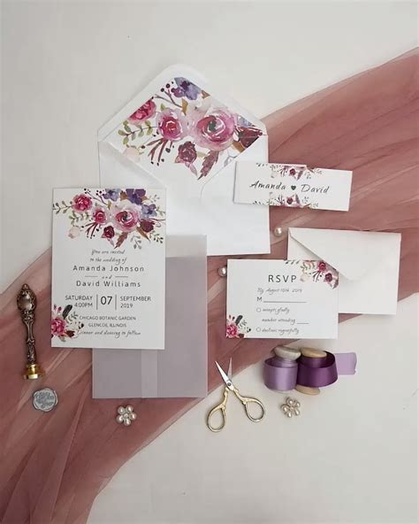 pink and purple floral wedding invitation with vellum