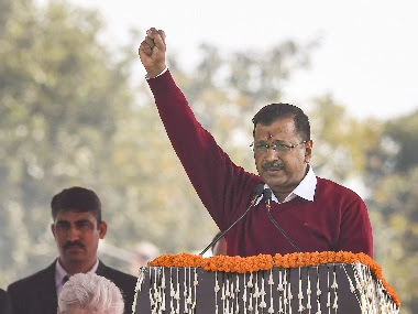Arvind Kejriwal raises slogans during his speech after he was sworn-in as the Chief Minister of Delhi for the third time. PTI
