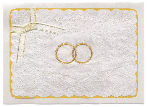 Beautifully embroidered interlocking gold wedding rings centered in a