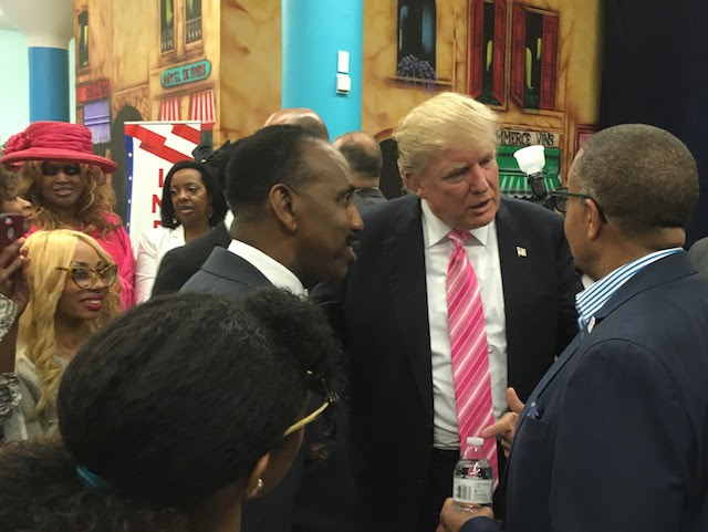 Left to right, Bishop Jackson, Trump and Detroit police chief James Craig chat during the meet-and-greet