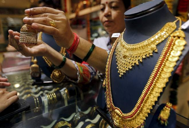 Gold price slips on global cues, subdued demand