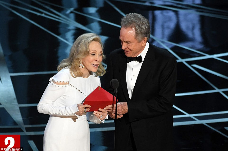 Beatty opens the envelope, sees the words 'Emma Stone from La La Land' and confusion spreads across his face. He looks to Dunaway, who reads out 'La La Land' as the Best Picture winner