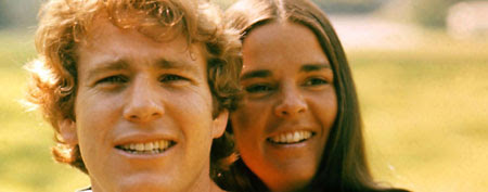 RYAN O'NEAL AND ALI McGRAW, LOVE STORY, 1970 (Mary Evans/PARAMOUNT PICTURES/Ronald Grant/Everett Collection)