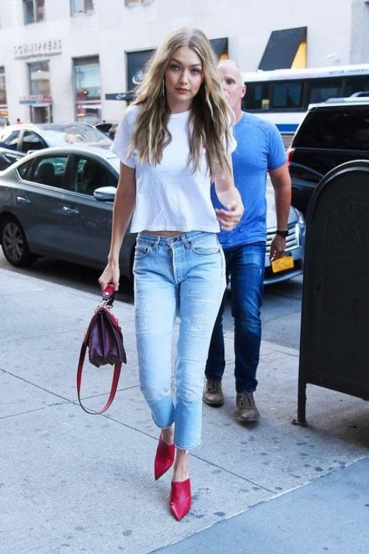 Le Fashion Blog Gigi Hadid White T Shirt Distressed Light Wash Jeans Red Pointed Toe Mules Via Harpers Bazaar