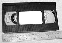 Photograph of a VHS cassette and a metric rule...