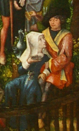 detail of the Archer's Feast by the Master of Frankfurt showing a woman looking into a man's eyes and running her hand up his leg