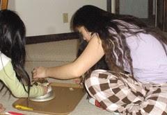 Girls Putting Mushrooms on Scale
