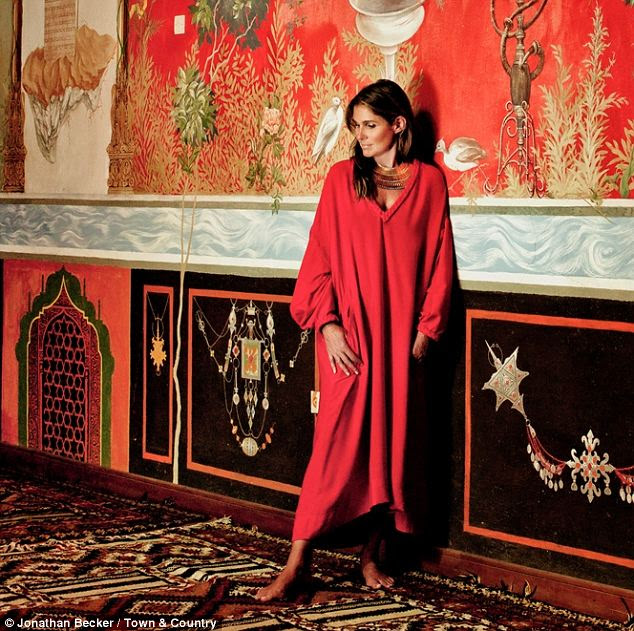 Elegant: The 42-year-old is seen in a red Hermes dress, above, paired with a dramatic Aurelie Bidermann necklace in the new issue of the magazine in which she discusses her sense of style