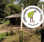 Thumbnail of This 2004 photograph depicted the entrance to a Nigerian Guinea worm containment center. The sign at the entrance displayed a drawing of a Guinea worm sufferer. Photo by E. Staub, CDC/Carter Center.