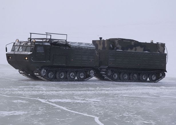 Putin's forces carry out major Cold War training exercise as they test 'promising new weapons' in Arctic temperatures of -30C