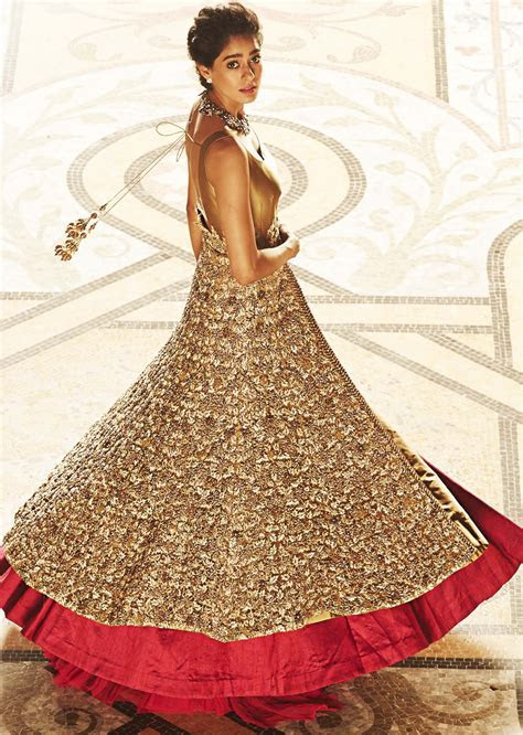 Long jacket lehenga in beige and gold enahnced in beads