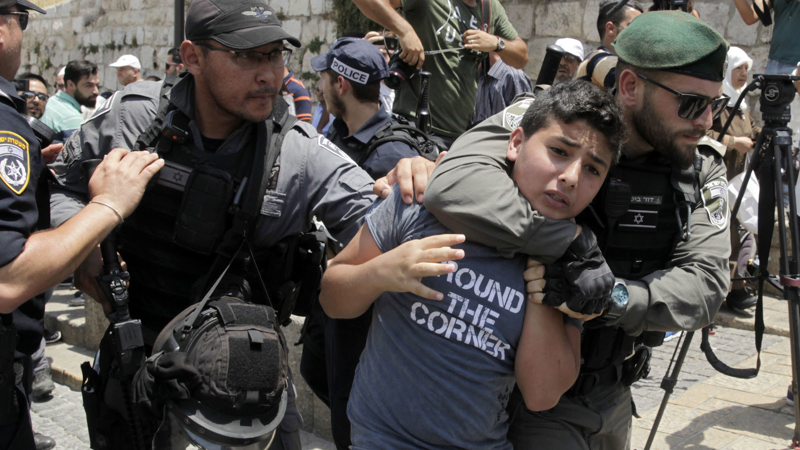 Israeli police place a Palestinian boy in a chokehold in Jerusalem's Old City, July 17, 2017. Muslims boycotted the Jerusalem holy site in a gesture of protest after Israel denied access to Muslims to Islam's second holiest site. (AP/Mahmoud Illean)