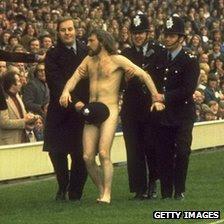 Police lead a streaker away