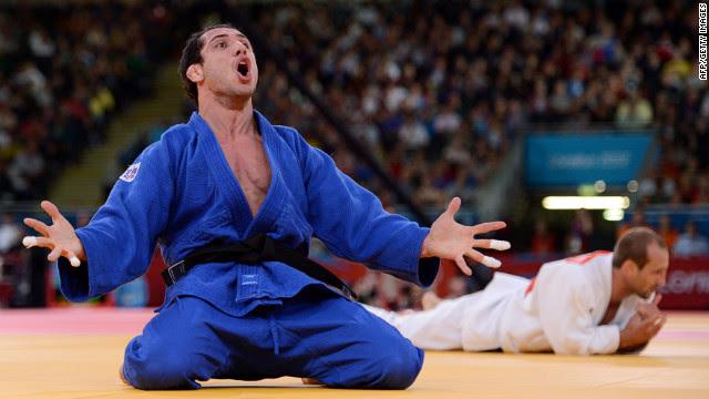 Argentina's Emmanuel Lucenti celebrates after beating France's Alain Schmitt in the men's under 81-kilogram judo contest match Tuesday.