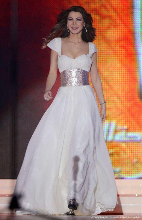 Lebanese singer Nancy Ajram performs dur   dresses   Nancy