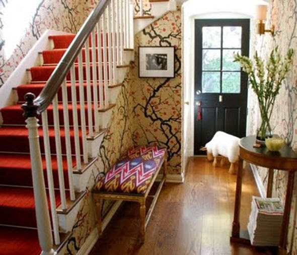 photo Green-Bicycle-Design-wallpapered-foyer-cherry-branches-ikat-bench-red-stairs.jpg