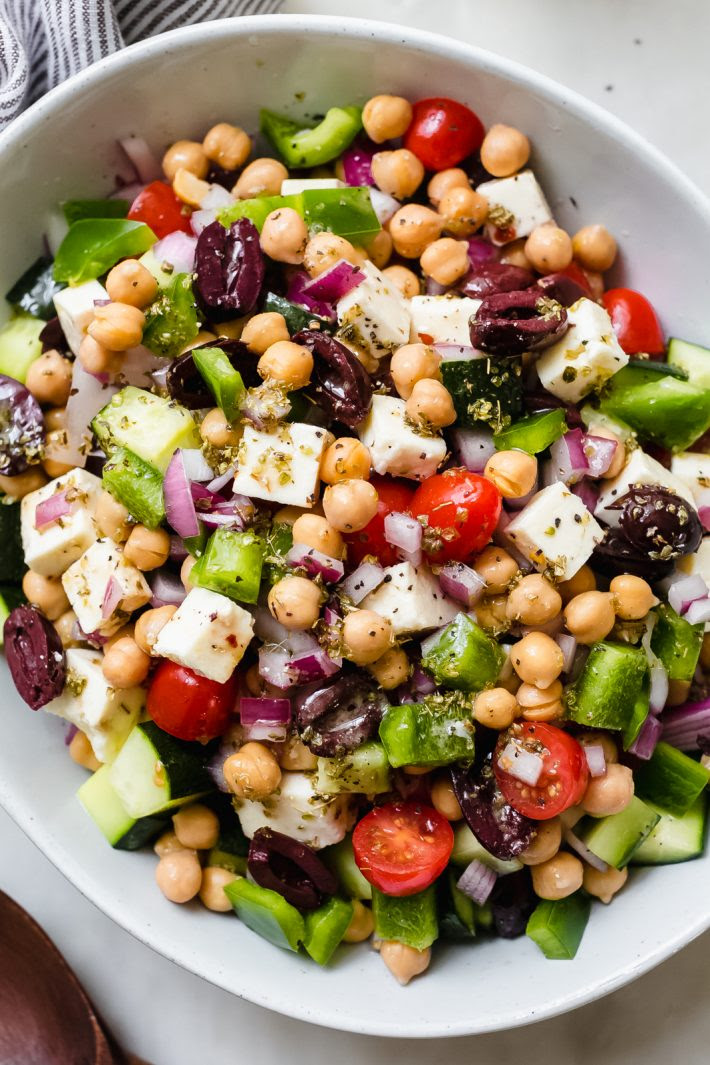 Marinated Feta Greek Salad - this is the best greek salad ever! It starts with feta that you marinated in olive oil with a few herbs and spices, then we'll toss it all together in a bowl with a homemade vinaigrette. Trust me, you'll never want a regular greeksalad again! #marinatedfeta #greeksalad #authenticgreeksalad #fetasalad #salad #saladrecipes | Littlespicejar.com