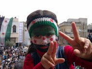 A picture released by the Syrian opposition's Shaam News Network on April 20 shows a girl with the colours of the ex-national flag painted on her face at an anti-regime protest in Talbisseh in Homs province. The United Nations Security Council unanimously agreed in a vote on Saturday to send 300 observers to Syria to monitor a shaky ceasefire as UN monitors visited the restive province of Homs. (AFP Photo/)