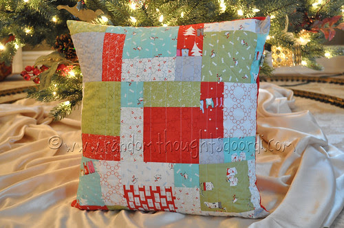 christmas pillow under tree