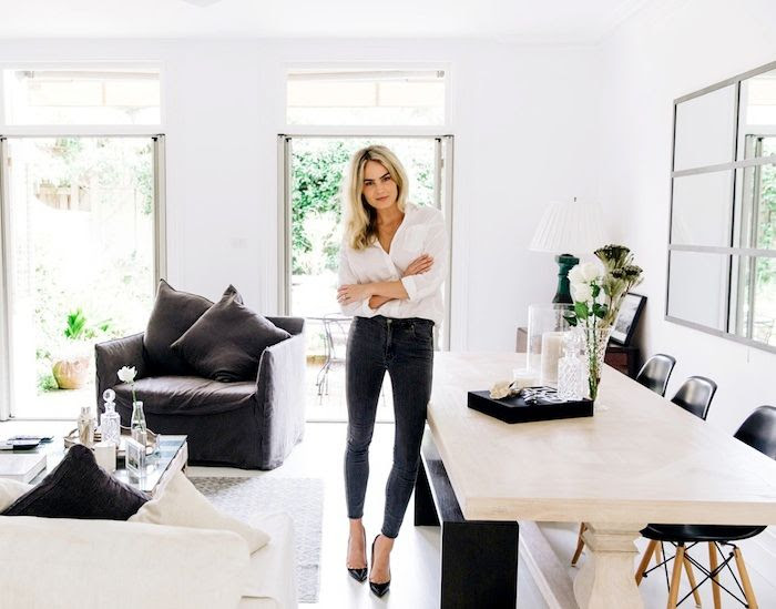 Le Fashion Blog Australian Blogger Brooke Testoni Bright Minimal Home Living Room Open Floor Plan French Doors White Sofa Black Dining Bench Slipcovered Chair Classic White Top Skinny Jeans Black Heels