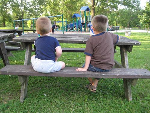 Boys eating dinner at the park