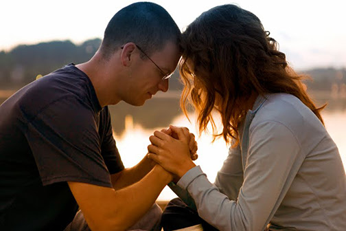 [Photo of a couple praying]