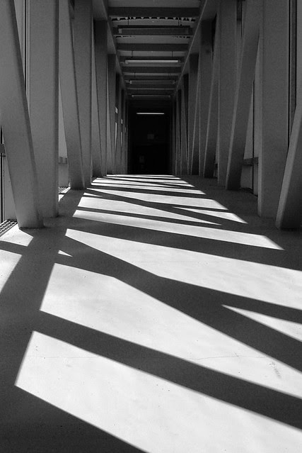 Shadows in a narrow enclosed bridge.
