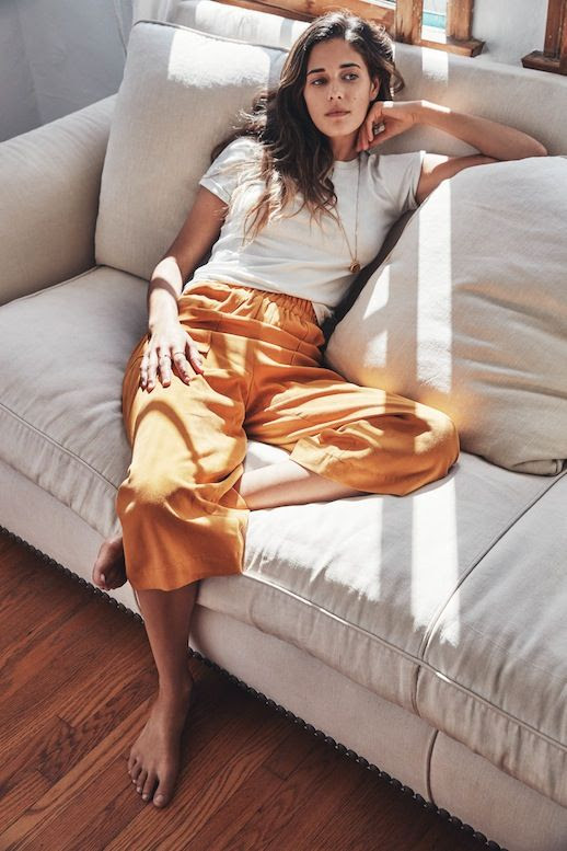 Le Fashion Blog Casual Weekend Style Inspiration White Tee Long Necklace Camel Orange Cropped Pants Effortless Hair Photo By Anais And Dax