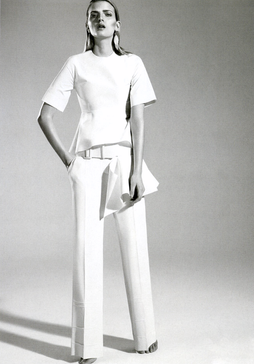 VOGUE RUSSIA LILY DONALDSON WHITE PEPLUM TOP WIDE WHITE BELT WIDE LEG PANTS CLUTCH FEATHER EARRINGS