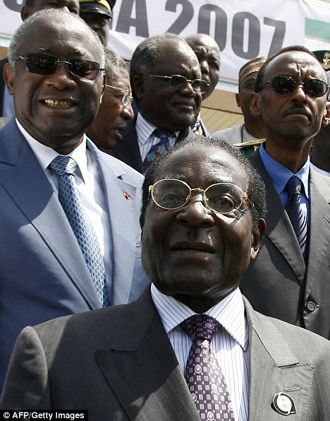 Presidents Robert Mugabe, centre of Zimbabwe and Paul Kagame, right, at an African Union summit in 2007
