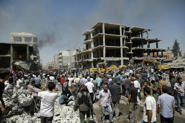 Des images de l'attentat montrent un secteur dévasté,... (PHOTO DELIL SOULEIMAN, AFP)